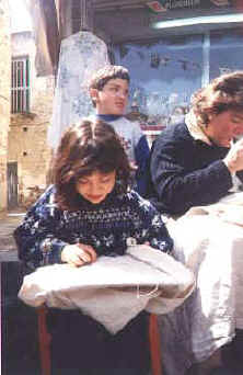 children lacemaking in the sunshine at Lefkara in Cyprus.jpg (26974 bytes)